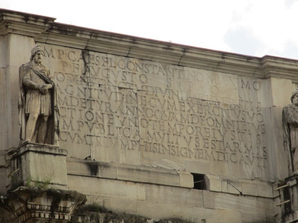 These letters used to be in bronze. They extol the virtues of the emperor Constantine.