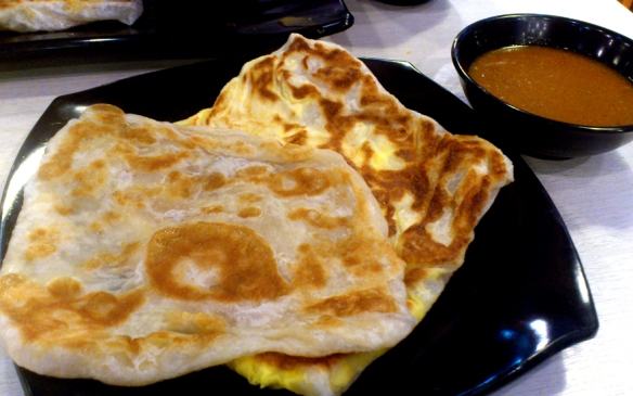 Roti Prata. Ever notice how oily food makes paper wrappers become clear? Rub roti prata on a concrete floor and it will become clear.